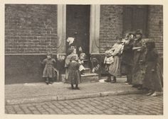 Children waiting outside a door, London, 1899.  Photograph by Mr. H.J. Malby.