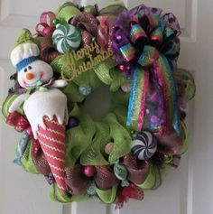 Deco Mesh wreath with candy snowman and candy colors bow