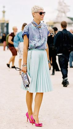 Pleated mint green skirt worn with a tropical print shirt and bright pink bow pumps