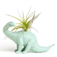A fun way to decorate any desktop, table, or bureau- our New Dino Planter is a re-purposed toy that has been primed, painted with 4 coats of Paint