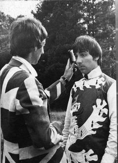 Keith Moon having his hair brushed by Pete Townshend