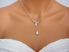 Silver Double Orchids Teardrop Pearl Lariat by ACutieChick on Etsy, $26.00