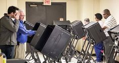 ''A Wichita State University mathematician sued the top Kansas election official Wednesday, seeking paper tapes from electronic voting machines in an effort to explain statistical anomalies favoring Republicans in counts coming from large precincts across the country.''