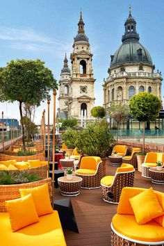 The rooftop bar at music-themed Aria Hotel in Budapest offers views of St Stephen's Basilica from the yolk-coloured seats. Hotel Rooftop Bar, Rooftop Bar Bangkok, Best Rooftop Bars, Budapest Travel, Hotel Budapest, Treehouse Hotel, Brick Arch, Hungary Travel, Sky Bar