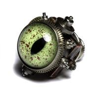 Reptile steampunk eye pin by *CatherinetteRings on deviantART