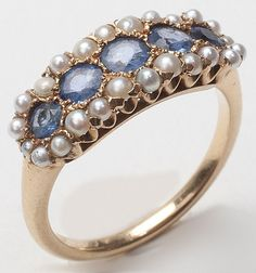 Pretty vintage gold sapphire seed pearl anniversary ring.