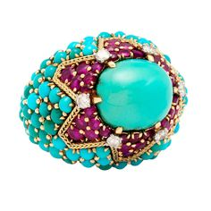 Magnificent Marchak Paris Turquoise and Ruby bombe Ring | From a unique collection of vintage cocktail rings at http://www.1stdibs.com/jewelry/rings/cocktail-rings/
