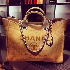 Beach bag - Right... Cos a girl really wants to take her chanel bag to the beach...