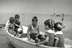 JFK with his siblings in a boat