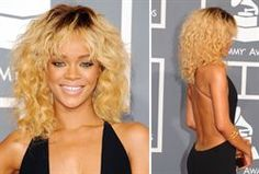 Rhianna's Grammy look~ Tina Turner inspired! I'm lovin' the texture, but I'm not feelin' the color and root look! what do you guys think?