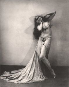 Russian dancer Vera Fokina in a bandeau top and long split skirt. Circa 1925.