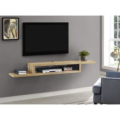 Float the Martin Furniture 72 in. Asymmetrical Wall Mounted TV Shelf below your wall-mounted television for convenient storage of your television component. Wall Mount Tv Shelf, Wall Mounted Tv, Mounted Tv Decor, Tv Wall Shelves, Diy Shelving, Mounted Shelves, Wooden Shelves, Glass Shelves, Shelves Under Tv