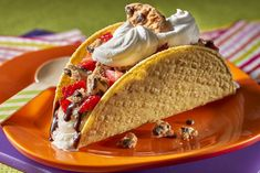 CHIPS AHOY! Ice Cream Tacos Recipe ---- I like to put the taco in the freezer with some magic shell chocolate in a drizzle pattern before filling.