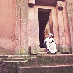 Priest at the #ChurchofStGeorge carved from rock in the shape of a cross. #Lalibela #Ethiopia. One of 11 monolithic churches - carved from a single block of stone - in the area dating back to the 12th and 13th centuries. This church was carved from tufa a variation of limestone. The churches are still active today and Lalibela continues to be a pilgrimage site for members of the Ethiopian Orthodox faith. #wanderlust #photos #gratitude #erikalafrennie #travelphotography #ladyboss…