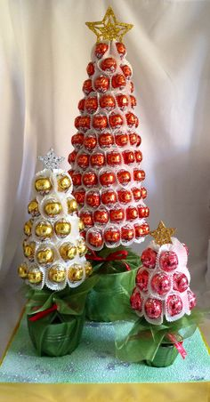 Trio of Lindt Xmas candy trees www.sweetcandytablesbuckinghamshire.co.uk Chocolate Tree, Christmas Chocolate, Christmas Candy, Christmas Treats, Xmas, Candy Trees, Sweet Trees, Rustic Wedding Centerpieces, Candy Bouquet