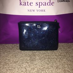 NWOT Kate Spade Mavis Street Mini Pouch Authentic Kate spade Mabus Street many pouch in blue glitter. Has a zip top closure. Two card slots on the inside. Never been used.                  Measurements: 6.5L x 4.75H kate spade Bags Cosmetic Bags & Cases