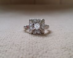 This Gorgeous 1930s Diamond Ring features an Antique White 14K Gold Setting. Set with 0.44 carats of Natural Diamonds. Stunning!! Makes a great