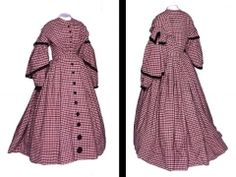 The Bowes Museum: Woman's Day Dress -  England ca. 1860 - Wool and cotton long sleeved dress in red, cream and black check. It is trimmed with black velvet ribbon and buttons. The wide 'V' shape design of the bodice of this dress was popular in the 1840s and 50s. The dress has four pleats which emphasize this shape. The sleeves accentuate the drooping shoulder line. The matching black velvet covered buttons, increasing in size, continue from the bodice to the bottom of the skirt.