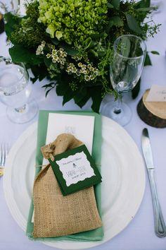 burlap wedding favor bags and green table place settings http://www.weddingchicks.com/2013/09/23/romantic-woodland-wedding/