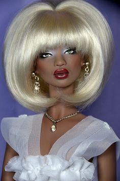 Numina Stratus wearing blond bouffant wig