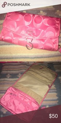 Like New Coach Hanging Jewelry and Accessory Bag Adorable and in Excellent Used Condition Coach Signature Jewelry and Accessory Bag. Hangs open to Reveal 3 Different Sections with 7 Different Compartments. Perfect for Travel!!! This Bag is a must have💕 Coach Bags