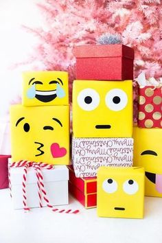 """had to emoji-fy another holiday DIY this go-around! Emoji gift wrap with just yellow paper and some cardstock is right up my """"Oops I forgot to wrap that present ahhhhhh! You can snag a roll of paper at the art store and you're good to go! Party Emoji, Homemade Christmas Gifts, Holiday Gifts, Christmas Crafts, Emoji Christmas, Christmas Holidays, Christmas Colors, Christmas Decorations, Creative Gift Wrapping"""