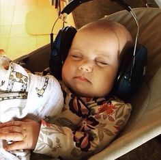 Baby Lucille asleep with headphones on. Zac's youngest