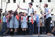 Jeremiah Fraites and Wesley Schultz of The Lumineers perform with the Success Academy 2 Bronx Children's Choir at the Governors Ball Music Festival.