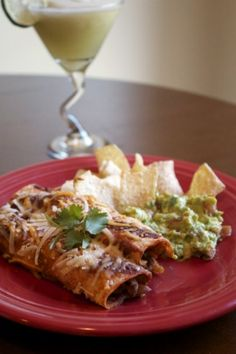 Celebrate Cinco de Mayo with these delish chick'n enchiladas! #vegan #recipe #fiesta