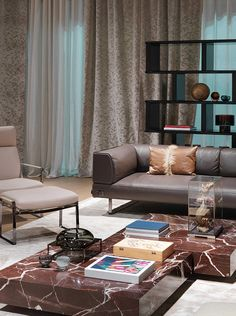 Fendi Casa - Blixen armchair and footstool, Quadrum Marble coffee tables and Soho Lite sofa www.luxurylivinggroup.com #Fendi #LuxuryLivingGroup