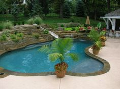 Retaining wall pool with slide
