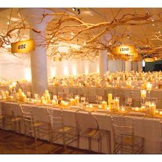 Love the idea of hanging branches covered with lights as venue or marquee decoration. Visit www.raspberrywedding.com for more ideas and inspiration.