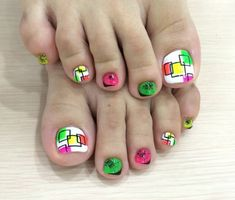 A fun and adorable looking toenail art design. Have this combination of white, black, and yellow, pink, red and green colors all painted on your toes. Sporting fun looking shapes that play around the nails, you can simply match it up with just any outfit.