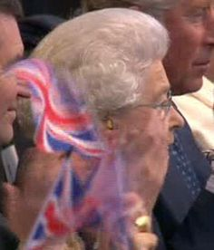 Being subjected to dancing dogs, pop stars you dont recognise and young people's music that is Too loud! The Queen looked to be enjoying the concert, although on closer inspection the Monarch took the precaution of wearing earplugs during the show