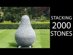 Balancing stones to create a sculpture of a pear. The rocks are slate, and are shaped to form a precise shape over the course of 3 weeks in my artist studio.