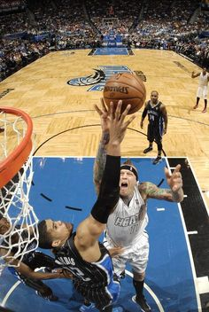 MARCH 25: Chris Andersen #11 of the Miami Heat and Tobias Harris #12 of the Orlando Magic battle for the ball