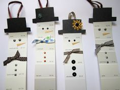 Paint chip snowmen.  Christmas giveaway. Could be used as a bookmark?? Kiddos would decorate using ribbon, stick-on gems, markers, & paper.