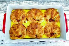 Flaky croissants, two kinds of cheese, bacon, and eggs make up this scrumptious breakfast casserole. Perfect for a Sunday brunch to begin your day of watching football with some friends, for a potluck at the office, or for a fun family gathering at the breakfast table on the weekend. For whatever occasion, this is sure to be a big hit.