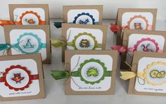 adorable creatures colored to match scalloped circle fram and ribbon...white topper on kraft base...delightful!!!