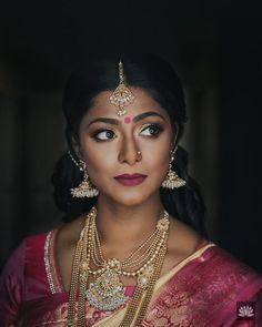 South Indian bride. Gold Indian bridal jewelry.Temple jewelry. Jhumkis. Pink silk kanchipuram sari. Braid with fresh jasmine flowers. Tamil bride. Telugu bride. Kannada bride. Hindu bride. Malayalee bride.Kerala bride.South Indian wedding. Pinterest: @deepa8