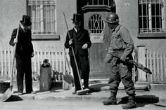 At the beginning of April 1945 Easy Company were deployed to the Ruhr  pocket, facing Sturzelberg, on the west bank of the Rhine. JD: Note the sign on the door; Keepsake is the 327th GIR, blue stands for 3rd battalion.