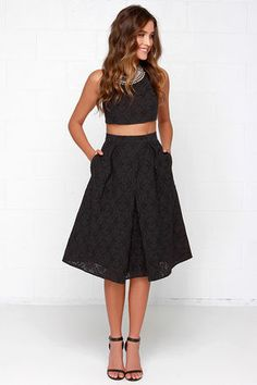 "You can relax knowing you're rockin' an on-point ensemble with the Piece and Harmony Black Two-Piece Dress! This puckered woven crop top with a tantalizing texture, and darted accents, is complemented by stretchy elastic trim that meets at a sliding, shiny gold closure at back. The matching midi-length skirt adds a classic touch with its banded waist, and asymmetrical box pleats. Skirt has hidden back zipper. Fully lined in stretch knit. Small top measures 13.5"" long. Small bottom measures…"