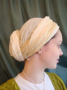 A regal chignon headscarf style that frames your face.