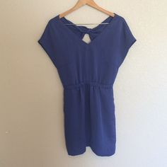 Indigo Dress This beautiful indigo colored dress has an elastic waist and a keyhole that ties in the back. It features a deep V neck line. Has pockets on each side. BCBGeneration Dresses