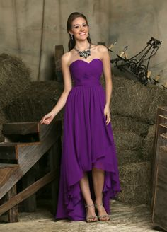 Choose Fall 2015 DaVinci Bridesmaid Style 60224 when you need a dress for bridesmaids and matrons of all shapes and sizes. This pretty, flowing, chiffon A line dress features a strapless, ruched bodice with a sweetheart neckline. Optional straps are included with each dress. The pleated belt at the natural waist will give any figure a defined waistline before the fabric drops into a breezy, hi-lo skirt with a touch of asymmetrical draping. Not only is this unique, high-low hemline…