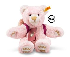 Lula the globetrotting Steiff teddy bear is a cute little girl teddy bear made of pink cuddly soft plush. As a present or a gift, your child will take Lula into his or her heart straight away. The rose/pink coloured backpack with its press stud is decorated with a beautiful flower. The backpack and passport are removable. Lula's paws are embroidered.