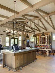 The tasting room at the Medlock Ames Winery in Healdsburg was originally an old farm store. Designed by Will Wick of San Francisco-based Wick Design, the interiors now feature a zinc tasting bar, salvaged lighting fixtures, and a large communal table with 1950s Walter Gropius chairs.
