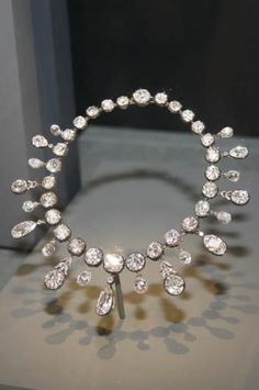 In 1810, Napoleon I of France divorced the Empress Joséphine, as she proved to be incapable of producing an heir. He re-married two months later to Archduchess Marie Louise of Austria. Within a year, Marie Louise bore a son. To celebrate, in June 1811 Napoleon I commissioned the Napoleon Diamond Necklace from the Parisian jewellery firm Nitot et Fils, at a cost of 376,274 French francs. This sum was the equivalent of the Empress's entire annual household budget.