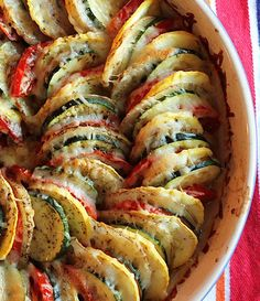 Vegetable Tian ~ Ingredients: 1 tablespoon olive oil 1-1/2 cups diced sweet onion, 1-1/2 teaspoons minced garlic, 1 medium zucchini thinly sliced,  1 medium yellow squash thinly sliced, 1 medium baking potato thinly sliced, 3 medium tomatoes thinly sliced, 1 cup shredded Italian cheese blend, Italian seasoning to taste, Salt and pepper to taste.