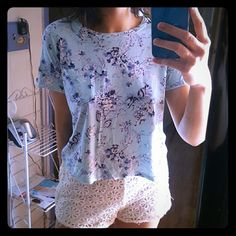 Final price. Forever 21 floral shirt Short sleeves, baby blue color with a pretty floral print, has a little pocket on the left side :) saids XS, but small and median people can fit as well since it runs big Forever 21 Tops Tees - Short Sleeve